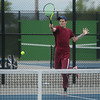 Joplin's Asa Borup returns a shot during district tennis play on Friday at Carthage.<br /> Globe | Roger Nomer