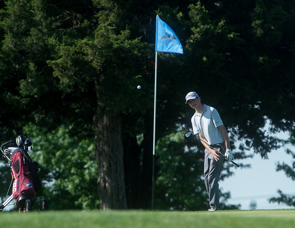 Joplin's Ethan Sage watches his shot fall on the green during sectional play at Schifferdecker Golf Course on Monday.<br /> Globe | Roger Nomer