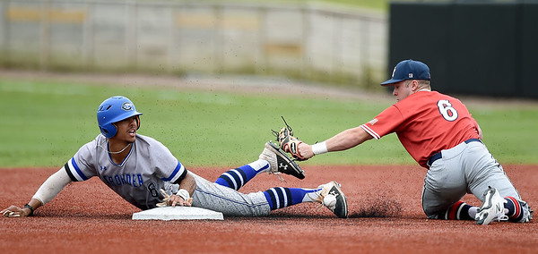 Crowder's Roderick Criss dislodges the ball from Jefferson College's Pate Fullerton as he slides safely into second base during their game on Friday at Joe Becker Stadium.<br /> Globe | Laurie Sisk
