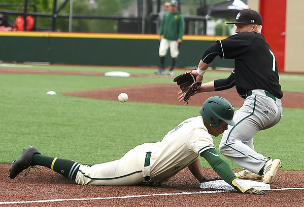Missouri Southern's Mike Million slides safely into third base as Northwest's Calvin Rudolph (7) fields the throw during their MIAA Championships opening game on Thursday at Pittsburg State's Al Ortolani Field. <br /> Globe | Laurie Sisk