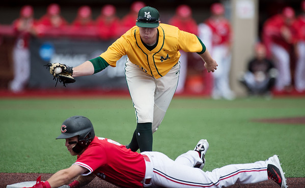 Missouri Southern's Matt Miller tags out Central Missouri's Michael Sinks during Sunday's MIAA tournament game against the University of Central Missouri at Pittsburg State University.<br /> Globe | Roger Nomer
