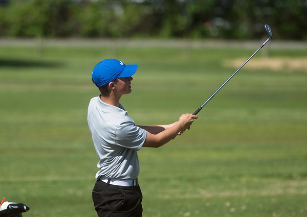 Carthage's Robbie Sager hits a shot during sectional play at Schifferdecker Golf Course on Monday.<br /> Globe | Roger Nomer