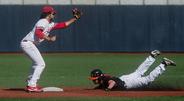 Republic's Jaden Duvall steals second ahead of a tag from Webb City's Zachary Biastock during Monday's game at Joplin High School.<br /> Globe | Roger Nomer