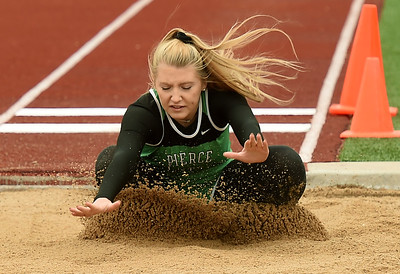 Pierce City's Bella Kamplain competes in the long jump during Class 2 District 5 Track and Field on Saturday at Sarcoxie High School. Globe | Laurie Sisk