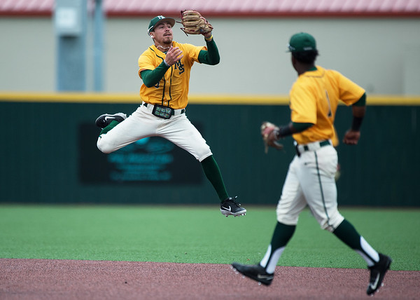 Missouri Southern's Denver Coffee checks his glove to see that he came up empty on a hopping grounder during Sunday's MIAA tournament game against the University of Central Missouri at Pittsburg State University.