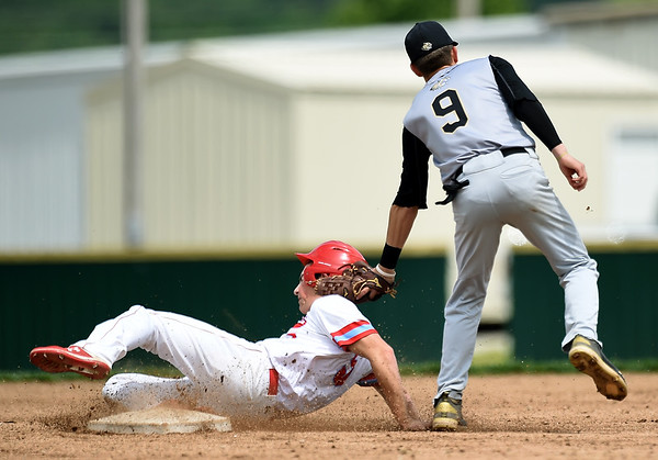 Webb City's Treghan Parker (5) hooks the bag for a stolen base as Neosho's Weston Durman (9) applies the tag during their game on Friday at Webb City.<br /> Globe | Laurie SIsk