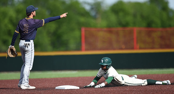 Missouri Southern's Dexter Swims slides well ahead of the throw as Central Oklahoma shortstop looks on during their game on Friday at Pittsburg State's Al Ortolani Field.<br /> Globe | Laurie Sisk