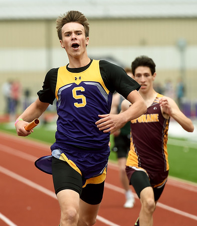 Sarcoxie's Michael Misner, left,  bests Spokane's Caleb Lovato for a first place finish in the 4x200 relay during Class 2 District 5 Track and Field on Saturday at Sarcoxie High School.<br /> Globe   Laurie Sisk