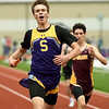 Sarcoxie's Michael Misner, left,  bests Spokane's Caleb Lovato for a first place finish in the 4x200 relay during Class 2 District 5 Track and Field on Saturday at Sarcoxie High School.<br /> Globe | Laurie Sisk