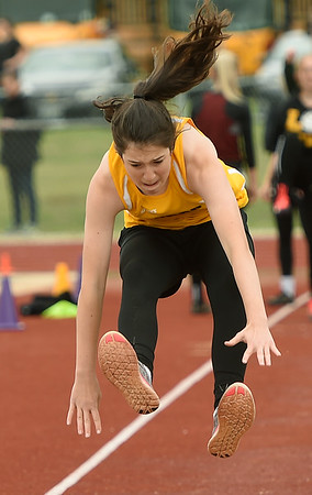 Purdy's Annabelle Bowman competes in the long jump during Class 2 District 5 Track and Field on Saturday at Sarcoxie High School. Globe | Laurie Sisk