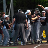 Willard teammates congratulate junior Cole Biellier after a solo home run during the Tigers Class 5 Sectional game against Webb City on Tuesday at Warren Turner Field.<br /> Globe | Laurie Sisk