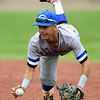 Crowder second baseman Jordan Hussein dives for a barehanded stop of an errant throw during the Roughriders game against Jefferson College on Friday at Joe Becker Stadium.<br /> Globe | Laurie Sisk