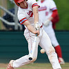 Webb City's Kade Hicks (7) connects for an rbi single during the Cardinals game against Neosho  on Friday at Webb City.<br /> Globe | Laurie SIsk