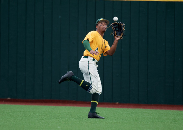 Missouri Southern's Mike Million tracks down a fly ball during Sunday's MIAA tournament game against the University of Central Missouri at Pittsburg State University.<br /> Globe   Roger Nomer