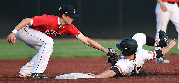 Outlaws' David Butterfield (27) slides safely under the tag of Nationals shortstop XX XX (2) during their game on Friday night at Joe Becker Stadium.<br /> Globe | Laurie Sisk