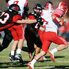 Globe/T. Rob Brown<br /> Lamar's Jacob Rice puts the stop of Caruthersville's Hunter Dickey Saturday afternoon, Nov. 17, 2012.
