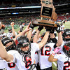 The Lamar football Tigers celebrate their Class 2 win with their trophy for the Class 2 championship in Edward Jones Dome in St. Louis. <br /> Globe/T. Rob Brown
