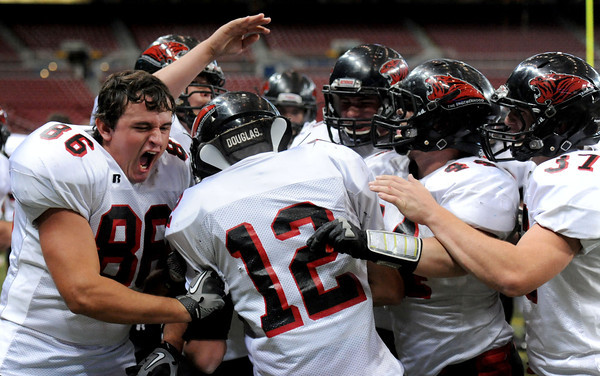 Cedric Gartman, 12, is surrounded by his teammates as they congratulate him for scoring a touchdown against Blair Oaks is the second half of the game in St. Louis. <br /> Globe/T. Rob Brown