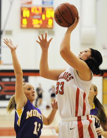 Globe/T. Rob Brown<br /> Carl Junction's Brenlee McPherson goes up for a shot over Monett's Lakin English during Thursday night's game, Nov. 29, 2012, in the Mercy Sportscare CJ Classic at Carl Junction High School's gymnasium.
