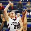 Globe/T. Rob Brown<br /> Joplin's #25 goes up for a shot over the Central opposition Tuesday evening, Nov. 27, 2012, during the first-round game of the 66th Annual Carthage Invitational at Carthage High School.