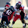 Globe/T.Rob Brown<br /> Lamar's defenders 42 and 8 bring down a Caruthersville player on Sat. Nov. 10, 2012.