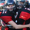 Globe/T. Rob Brown<br /> Lamar teammates Felix Beier (11) and Cedric Gartman (12) hug on the sidelines during the fourth quarter as the clock continuously ran Saturday afternoon, Nov. 17, 2012.