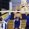 Globe/T. Rob Brown<br /> Ozark Christian College's Sarah Rhodes (10), of Miami, Okla., and Carrie Page (7) successfully block a kill attempt by Emmaus Bible College's Janae Squires Thursday evening, Nov. 1, 2012, during an ACCA National Championship game at OCC's gymnasium.