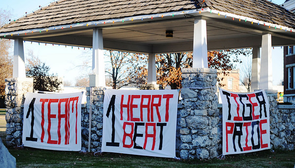 Globe/T. Rob Brown<br /> Lamar Tigers football fans show their support via banners that hang on a gazebo on the Lamar square Saturday afternoon, Nov. 17, 2012.