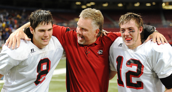Globe/T. Rob Brown<br /> Lamar coach Scott Bailey celebrates the team's state championship with two players at the Edward Jones Dome in St. Louis, November 2012.