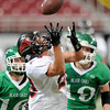 Lamar's ___ makes a catch over his shoulder during the Class 2 state championship game at the Edward Jones Dome at St. Louis.<br /> Globe/T. Rob Brown
