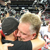 Head coach Scott Bailey, right, hugs assistant coach ___ as the Lamar Tigers celebrate their 69-41 Class 2 championship win over Blair Oaks at the Edward Jones Dome in St. Louis.<br /> Globe/T. Rob Brown