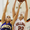 Globe/T. Rob Brown<br /> Carl Junction's Maria Chism gets a firm hold on a rebound as Monett's Faith Schmidt attempts to take it during Thursday night's game, Nov. 29, 2012, in the Mercy Sportscare CJ Classic at Carl Junction High School's gymnasium.