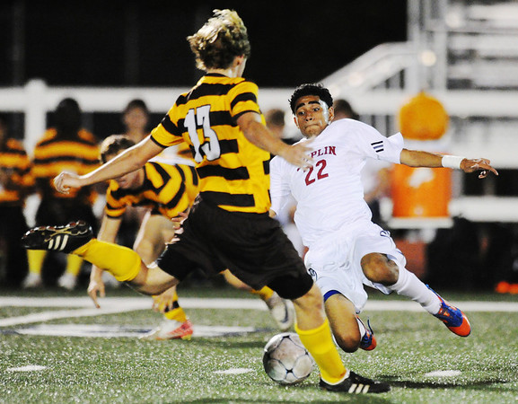 Globe/T. Rob Brown<br /> Joplin's Jonathan Ponce-Perez attempts to kick the ball away from Kickapoo's Mac Hoogeveen before Hoogeveen can kick the ball during Friday night's game, Nov. 2, 2012, in the MSHSAA Class 3 District 12 Boys Soccer Tournament at Junge Field.