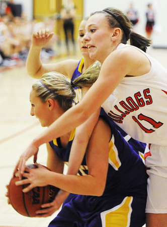 Globe/T. Rob Brown<br /> Carl Junction's Bradyn Wall competes with Monett's Lakin English for a rebound during Thursday night's game, Nov. 29, 2012, in the Mercy Sportscare CJ Classic at Carl Junction High School's gymnasium.