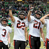 Lamar's team salutes the crowd upon winning the Class 2 state football championship against Blair Oakes by a score of 69 to 41 at the Edward Jones Dome in St. Louis. <br /> Globe/T. Rob Brown