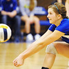 Globe/T. Rob Brown<br /> Ozark Christian College's Carrie Page gets low to keep the ball in play, reacting to a serve, Thursday evening, Nov. 1, 2012, during an ACCA National Championship game against Emmaus Bible College at OCC's gymnasium.