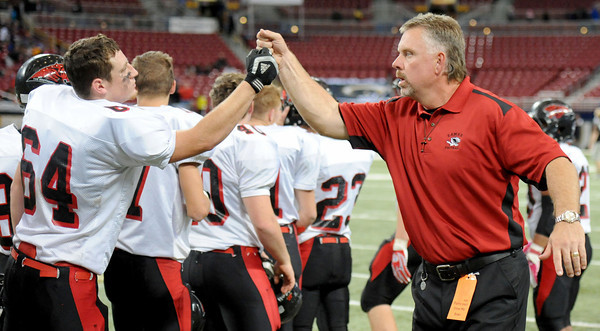Lamar coach Scott Bailey celebrates with the team after their 69-41 win against Blair Oaks for the Class 2 championship at the Edward Jones Dome in St. Louis.<br /> Globe/T. Rob Brown