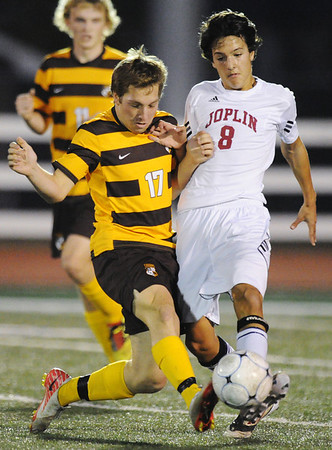 Globe/T. Rob Brown<br /> Joplin's Locke McAllister and Kickapoo's Derek Geeslin compete for control of the ball during Friday night's game, Nov. 2, 2012, in the MSHSAA Class 3 District 12 Boys Soccer Tournament at Junge Field.