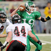 Lamar's JT Tucker, 44, and Chad Rice, 8, pressure Blair Oaks quarterback during the Class 2 championship game in St. Louis.<br /> Globe/T. Rob Brown