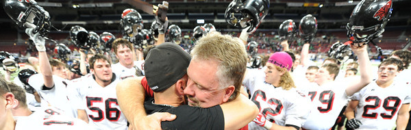 Globe/T. Rob Brown<br /> Lamar (Mo.) High School coaches hug as the team cheers behind them after winning the state title at the Edward Jones Dome in St. Louis in November 2012.