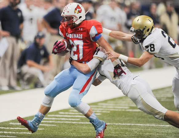 Globe | T. Rob Brown<br /> Webb City's Kyle Baldasarre pulls against two Helias Catholic defenders as they run him out of bounds Friday afternoon, Nov. 29, 2013, during the Show-Me Bowl at the Edward Jones Dome in St. Louis.