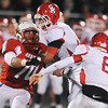 Globe/Roger Nomer<br /> Despite a block from Carl Junction's Zach Byer, Webb City's Tayler Arterburn gets a hand on Carl Junction quarterback Dustin Satterlee to force a sack during Monday's district game in Webb City.