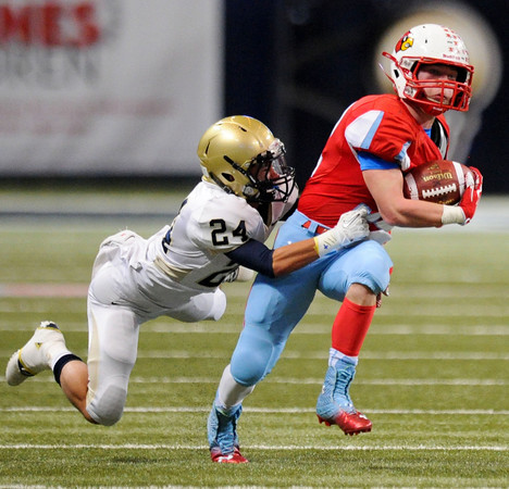 Globe | T. Rob Brown<br /> Webb City's Trey Parra pushes forward against the pull of Helias Catholic's John Rhea Friday afternoon, Nov. 29, 2013, during the Show-Me Bowl at the Edward Jones Dome in St. Louis.