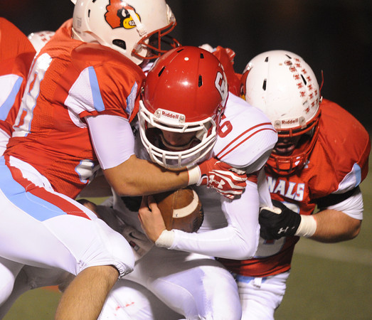 Globe/Roger Nomer<br /> Webb City's Steven Moore, left, and Tayler Arterburn sack Carl Junction's Dustin Satterlee during Monday's district game in Webb City.