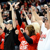 Globe | T. Rob Brown<br /> Lamar fans (from left) Josh Baird, a 2012 graduate who played for Lamar at the Dome, cheers a touchdown with help from his parents Donette and Jeff Baird, all of Lamar, Friday evening, Nov. 29, 2013, during the Show-Me Bowl at the Edward Jones Dome in St. Louis.