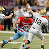 Globe | T. Rob Brown<br /> Webb City's Brian Arterbum moves in on Helias Catholic quarterback Wyatt Porter Friday afternoon, Nov. 29, 2013, during the Show-Me Bowl at the Edward Jones Dome in St. Louis.