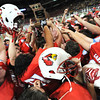 Globe | T. Rob Brown<br /> Webb City teammates hoist their helmets and the championship trophy  Friday afternoon, Nov. 29, 2013, after winning the Show-Me Bowl at the Edward Jones Dome in St. Louis.