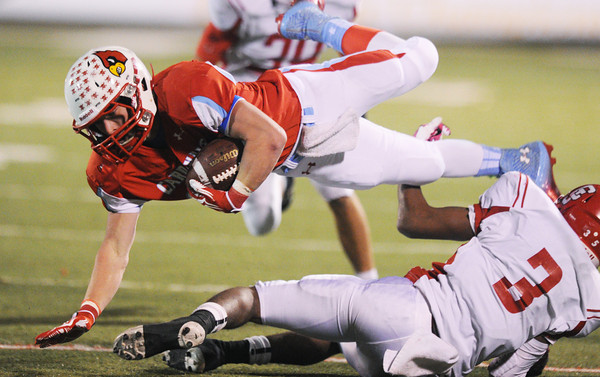 Globe/Roger Nomer<br /> Webb City's Trey Parra dives for crucial first down yardage over Carl Junction's Matt Magee during Monday's district game in Webb City.