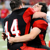 Globe | T. Rob Brown<br /> Lamar's JT Tucker (44) hugs teammate Jackson Gilkey Friday evening, Nov. 29, 2013, following their win at the Show-Me Bowl in St. Louis.