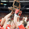 Globe | T. Rob Brown<br /> Webb City teammates celebrate their 28-14 win with the championship trophy at the Show-Me Bowl Friday afternoon, Nov. 29, 2013, at the Edward Jones Dome in St. Louis.